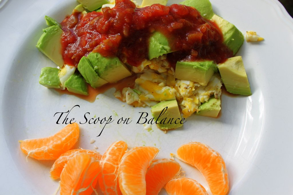 Scrambled eggs, half avocado, salsa, tangerine
